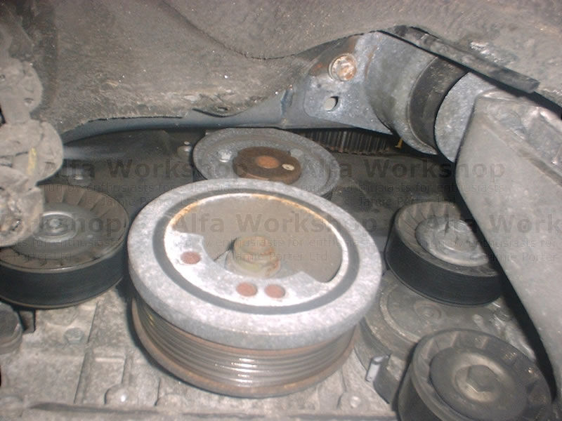 <p>Remove the auxiliary drive pulley and then both the lower covers are accessible these are secured by three 5mm allen keys and these are a bit tricky to get to and will include much skinning of knuckles. The cam belt is now accessible and can be removed by loosening its tensioner. <br />Before refitting it is worth considering fitting a water pump especially on the 2.5 V6 as the plastic impeller cracks and causes problems with engine cooling. It is always necessary to replace the tensioner as they wear out and if they break they will destroy your engine. In order to refit the cam belt it is necessary to loosen all the cam drive pulleys as they need to rotate to get the correct tension on the belt, once they are loose, tension the belt and then do up the pulley securing bolts.</p><p>From here on it is only a case of reversing the above procedure.