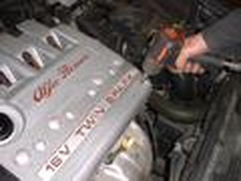 <p>The first task is to remove the upper rocker cover which is secured by 4 ribe fasteners, once this is removed the plug leads and coil packs are exposed, these are secured by 3 fasteners on vehicles with an alloy rocker cover and 4 on plastic rocker cover cars, the plug caps can then be carefully removed and put to one side.