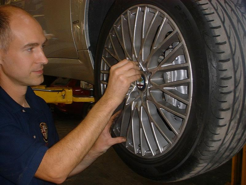 <p>Loosen the wheel nuts. Elevate the vehicle, place on two axle stands on a hard surface and remove the front wheel.