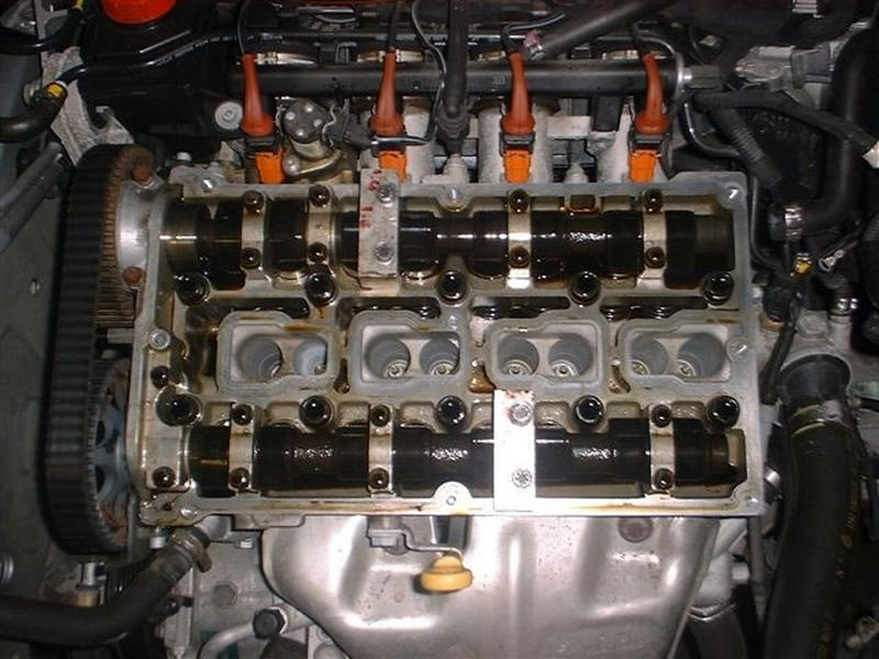 <p>Rotate engine until locking tools fit on camshafts.