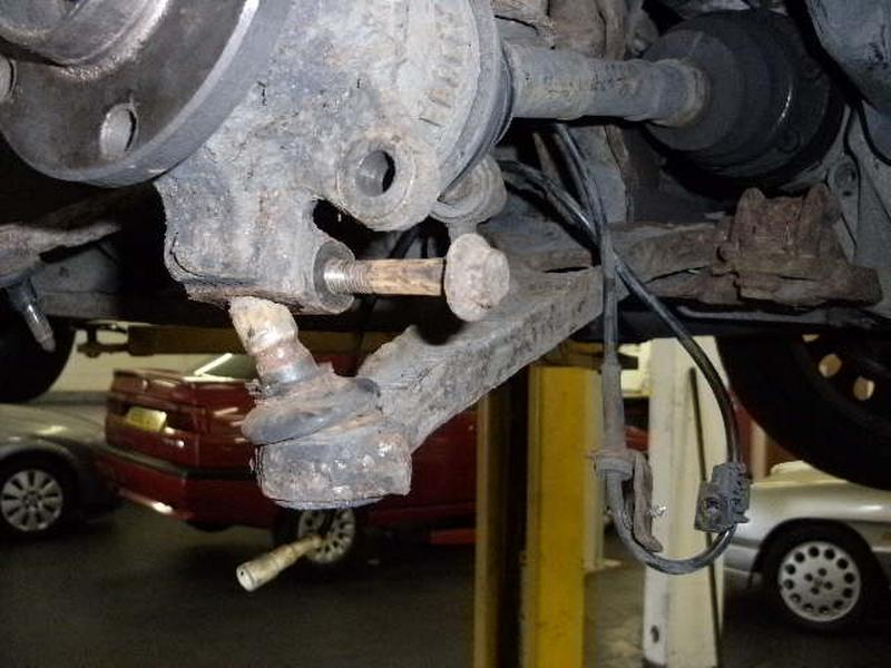 <p>Remove lower ball joint and then the two bolts that secure the hub to the shockabsorber
