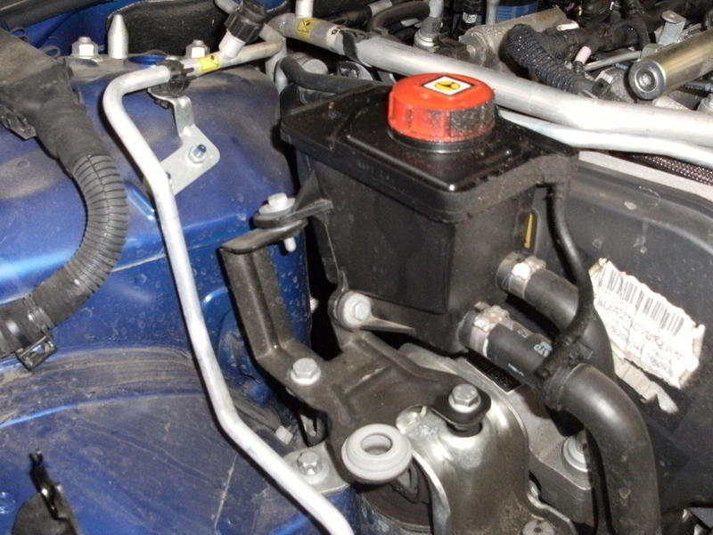 <p>First of all remove top cover of the engine and then remove the power steering fluid reservoir from its mounting