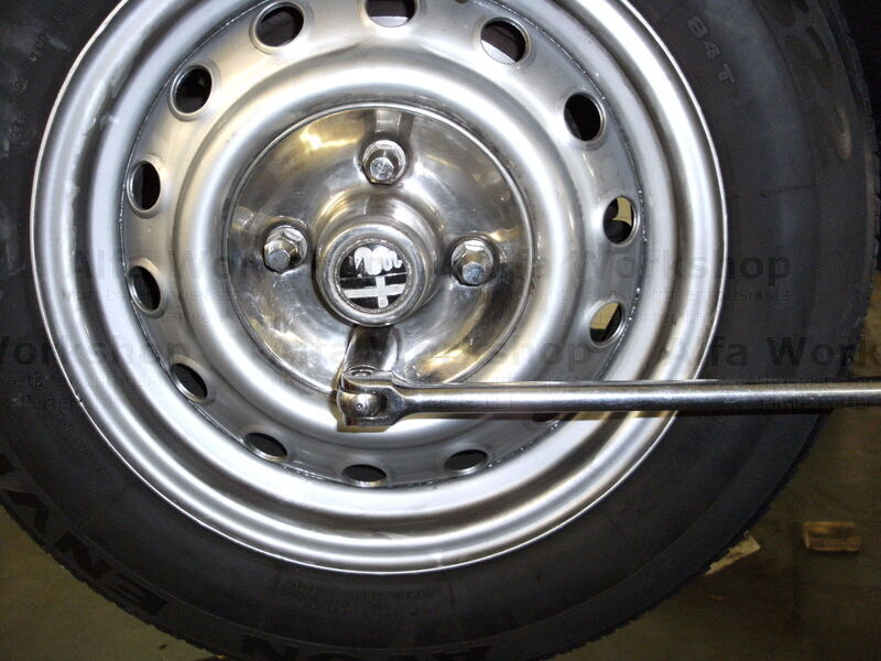 <p>Remove wheel, on early cars with brass wheel nuts the left hand side of the car will have wheel nuts that undo clockwise!