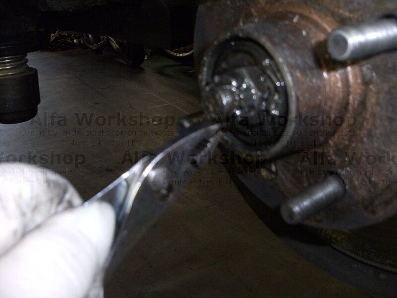 <p>Remove split pin from bearing and undo securing nut, the nearside undoes anti clockwise and then remove the hub assembly from the car.
