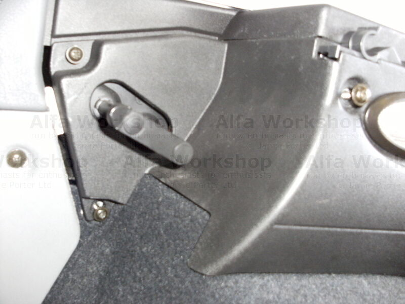 <p>Remove the three screws that retain the panel, then carefully prize out the two retaining clips to the rear of the panel.