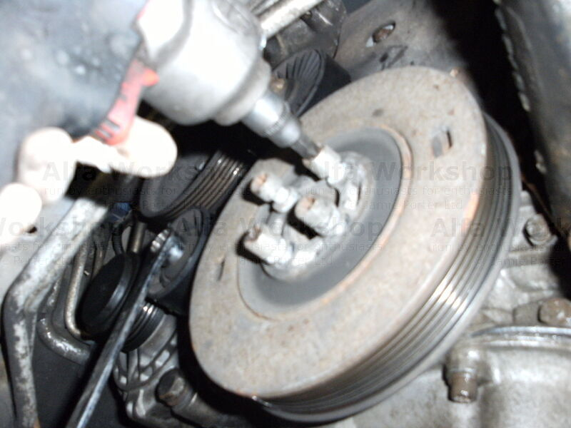 <p>Remove auxiliary drive pully