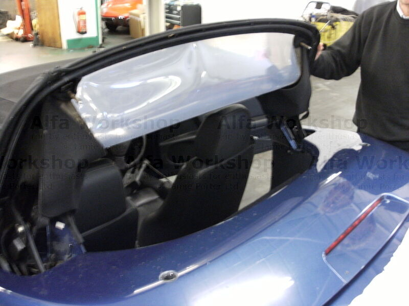 <p>This is quite an easy job to do but we are going to fit the window and its surround as well, not just the window. First of all lift the rear of the hood up.