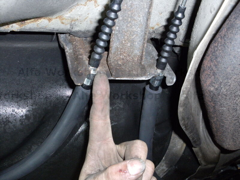 <p>Pull handbrake cable out of retaining clip in the middle of the car.