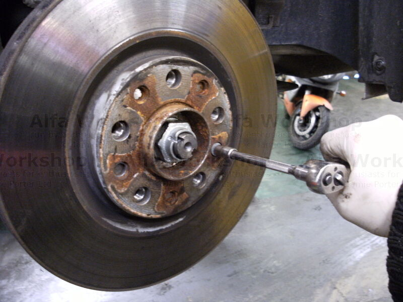 <p>Undo the brake disc retaining screw and remove the brake disc.