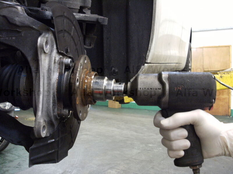 <p>Undo the hub nut, a nut gun is best for this as it is difficult to hold the hub still when using a spanner.