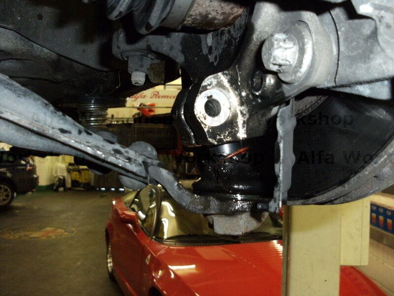 <p>Undo the lower ball joint and swing wishbone backwards