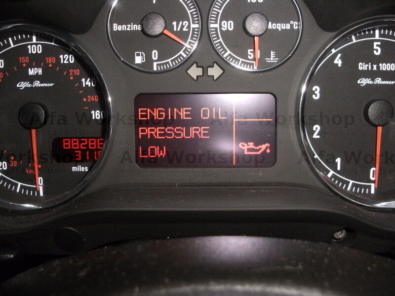 <p>You have no oil pressure turn engine off immediately and check oil level you will almost certainly be below minimum. if this light comes on the engine will usually need 3 litres of oil but you HAVE to check it on the dip stick. DONT just check it once check it at least 3 times and make sure you get two consecutive readings that are the same. Maximum to minimum on the dipstick is one litre.