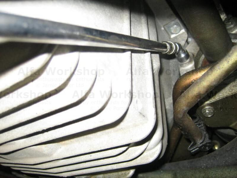 <p>Remove the three 10mm bolts that secure the right hand drive shaft, a long extension and a flexible socket work wonders here.