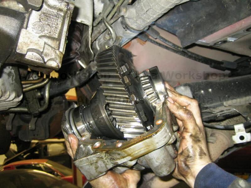 <p>Remove both drive shafts from the Q2 differential, then remove both gearbox seal carriers, then unbolt the differential casing and drop the differential out of the car.