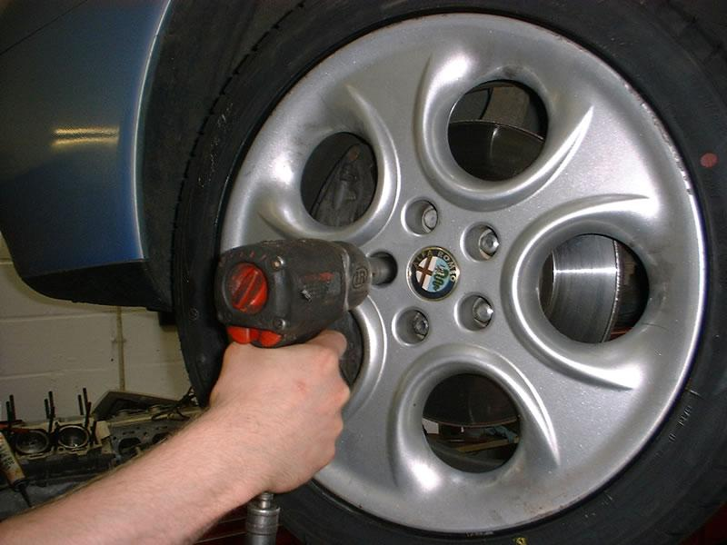 <p>Loosen wheel nuts then elevate the vehicle, mount safely on two axle stands and remove the front wheel.