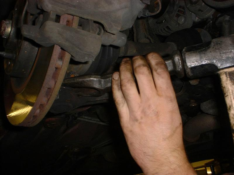 <p>Using special tool remove strut from lower wishbone