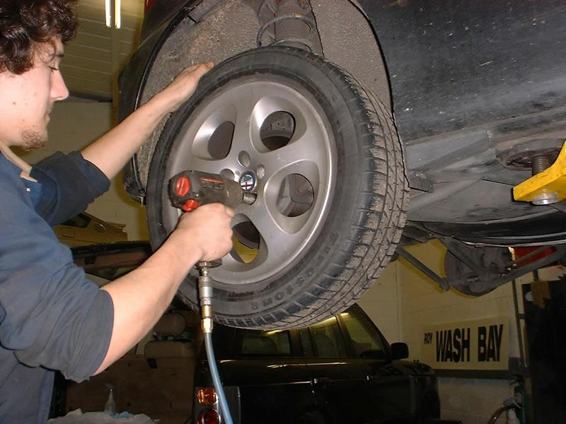 <p>Remove your Alfa's road wheel. (Without the benefit of a hoist, put car in first gear, loosen the wheel nuts slightly, raise and support the rear safely on two axle stands, remove the wheel nuts and wheel)
