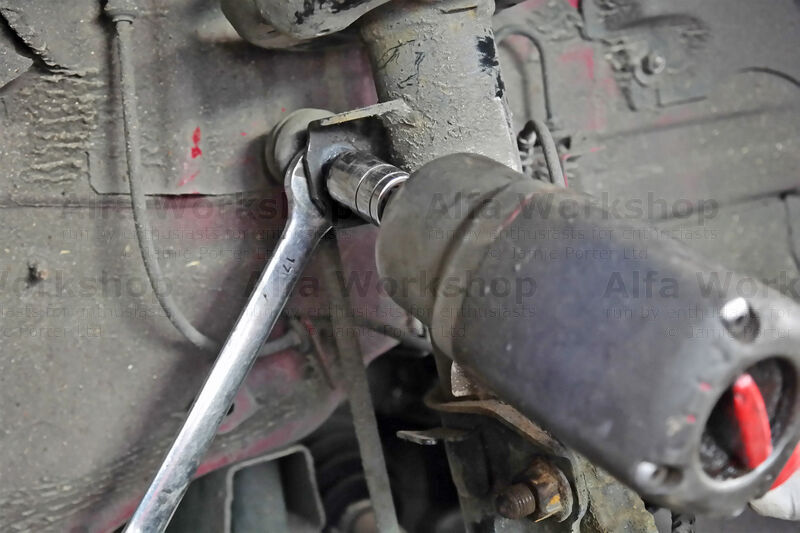 <p>Detach the top of the drop link from the shock absorber with a 17mm spanner &amp; 16mm socket.