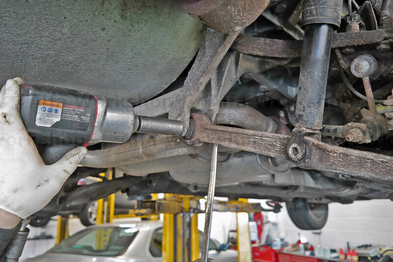 <p>Undo the subframe 19mm nut and remove the bolt.