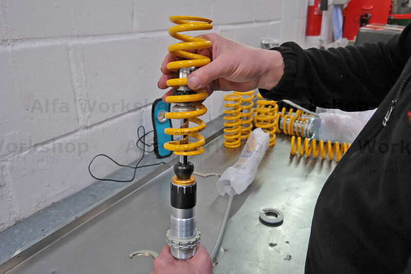 <p>You can now remove and replace the spring, then put together the Ohlins shock absorber.