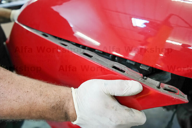 <p>Pull the sides of the bumper away from its clips.