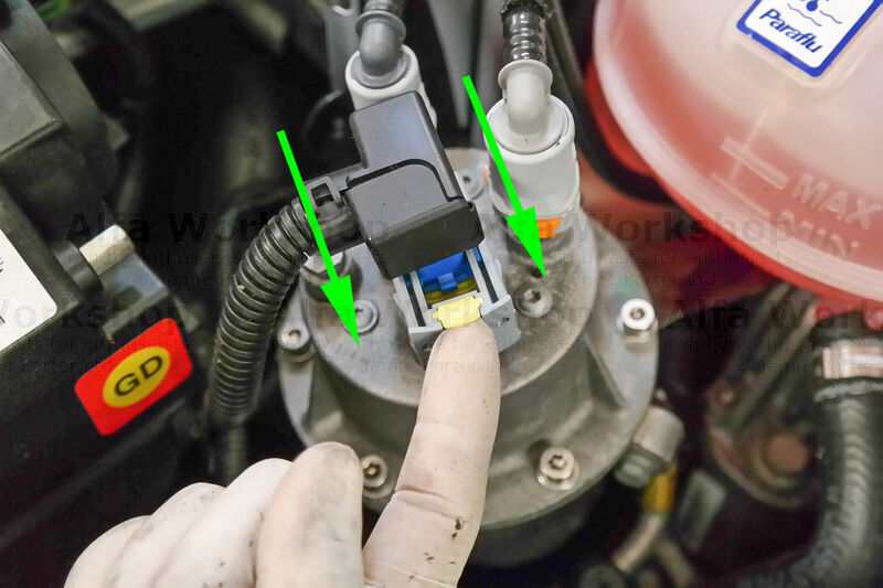 <p>To release the electric connector on top of the fuel filter lift up the yellow tab then squeeze the sides and slide out.