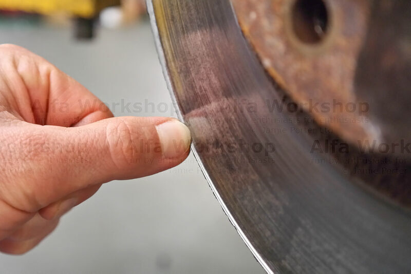 <p>Check if there's an outside lip developing on the front face of the brake disc (this disc has), pitting....