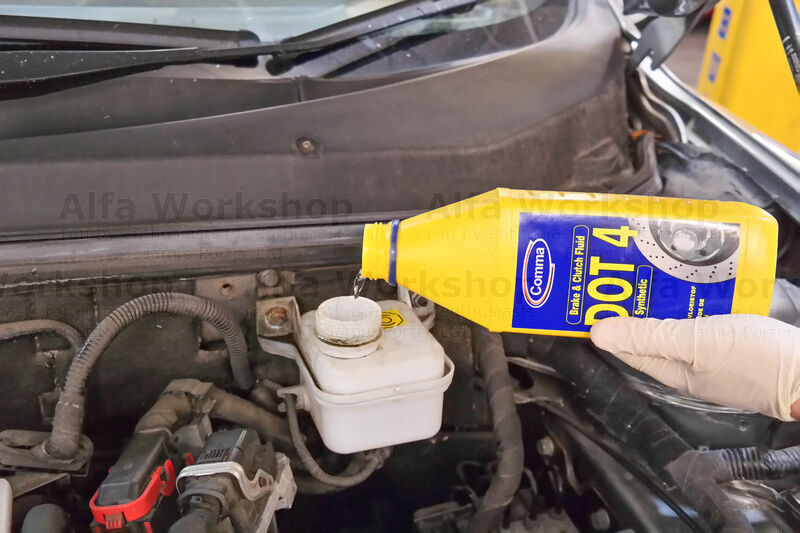 <p>Do this until the brake reservoir is almost empty (don't go beyond otherwise you'll trap air in the system) then top it right up with DOT 4 fluid. Bleed each caliper about 250ml whilst keeping the reservoir topped up.