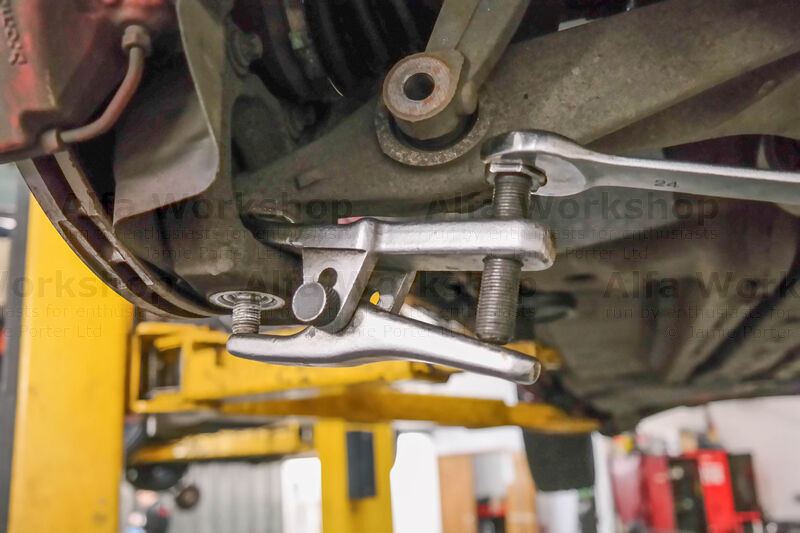 <p>Use a ball joint splitter to separate the ball joint from the bottom of the pillar, if you don't have one then a few choice strikes with a copper hammer to the side at the bottom of the pillar will have the same effect.