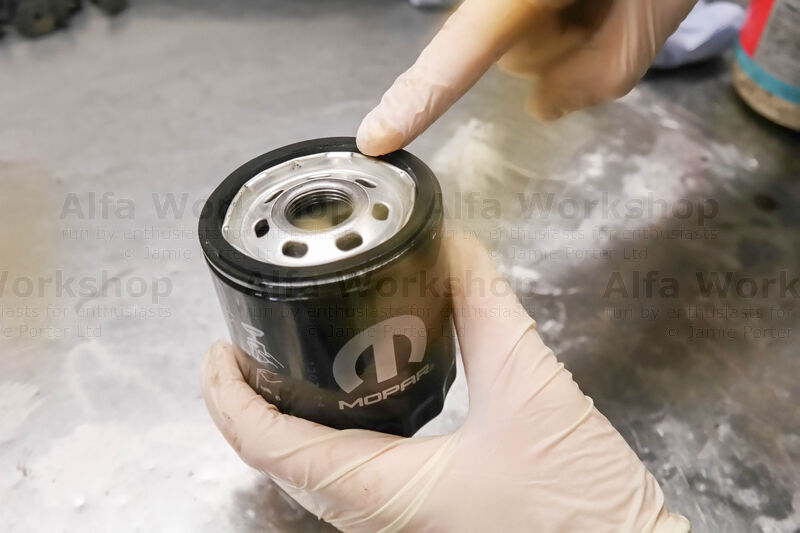 <p>Smear clean engine oil over the surface of the seal on the oil filter.
