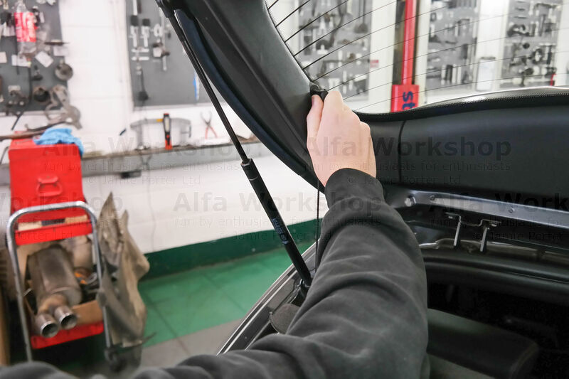 <p>Lift up the boot and unclip the x2 parcel shelf straps.
