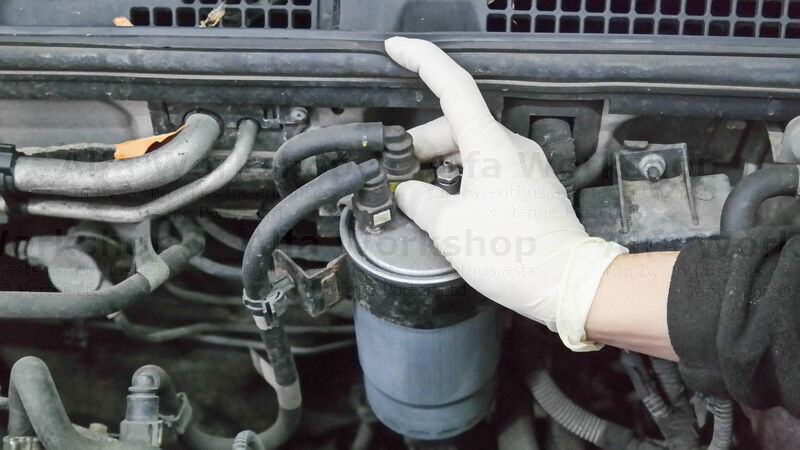 <p>Disconnect the inlet fuel line to the fuel filter.....