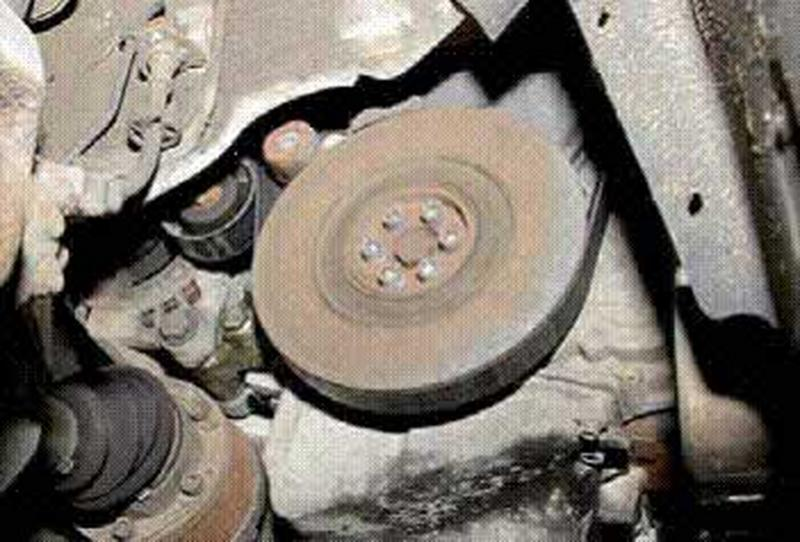 <p>Remove auxiliary belt, note that the adjustment is on the idler in front of the drive pulley not the tensioner behind the drive pulley. There is also a rubber insert in the centre of the drive pulley and this has a tendency to fail causing a rattling noise either when cold, on full lock or with the air conditioning on.