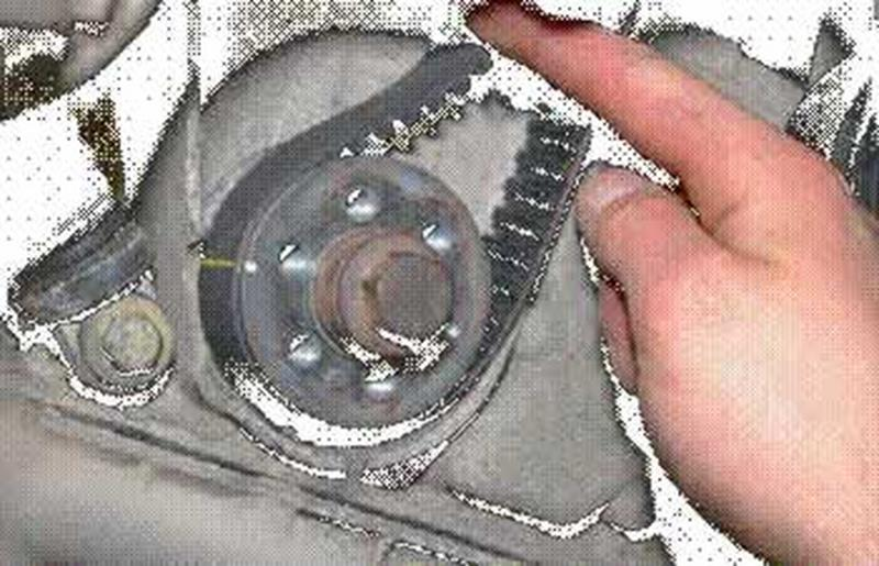 <p>....while the other one lines up with the mark on the crank pulley.<br />The pump requires no alignment as it is just a pressure pump.<br />Tension the belt.<br />Correct tension is indicated when the arrow on the tensioner lines up with the hole in the tensioner's body.<br />Turn the engine over 2 complete turns.<br />Reassemble in the reverse order.