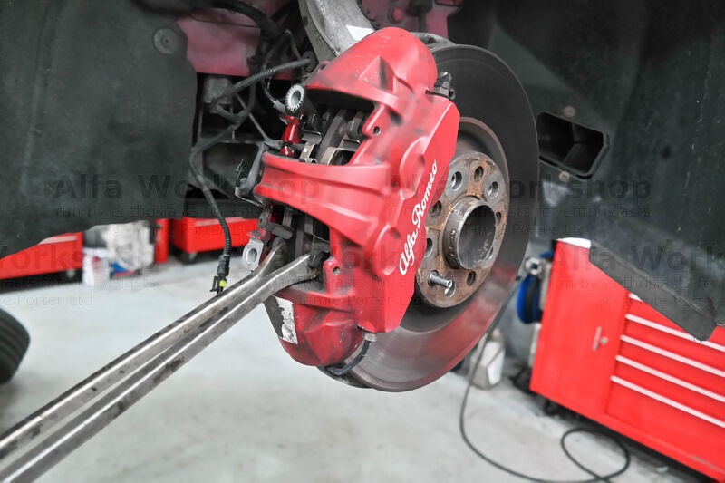 <p>Using two levers prise in the pistons (the caliper should now be loose).