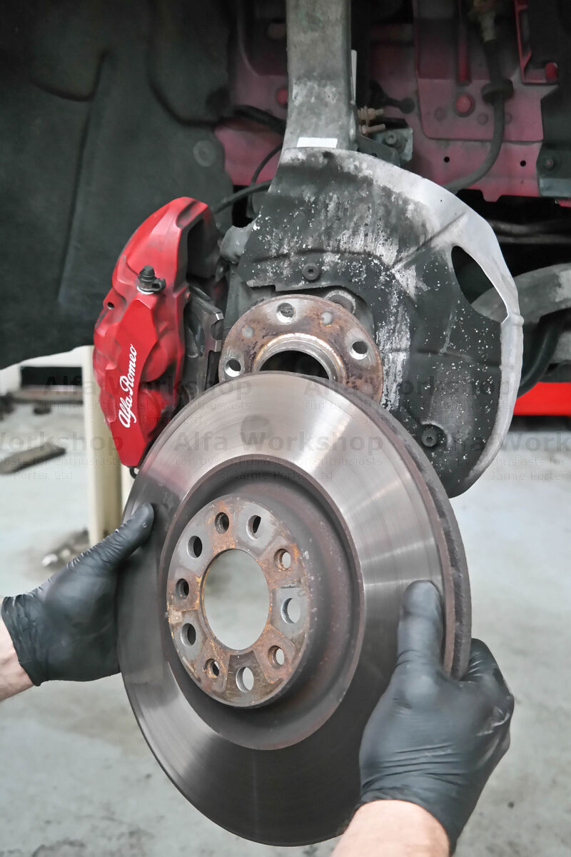 <p>Remove the old brake disc....