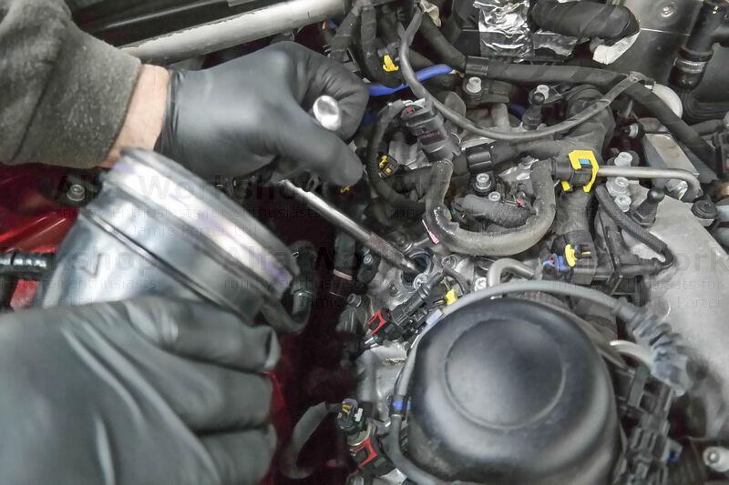 <p>Undo the spark plugs using a thin walled 14mm socket...