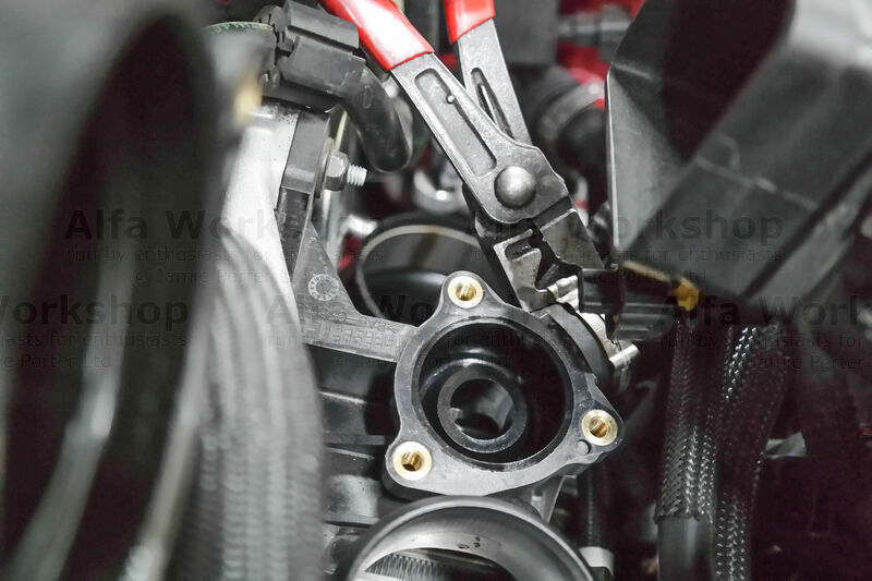 <p>Disconnect the quick coupling for the fuel vapour supply pipe to the turbocharger inlet then Remove the supercharging air by-pass sleeve on both sides.