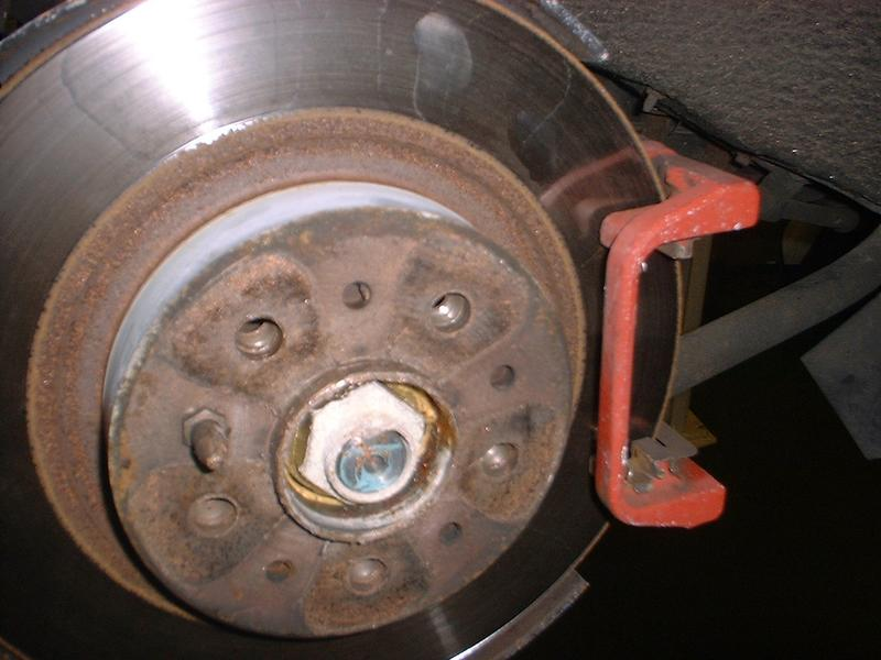 <p>Remove bolt securing disk and then remove disk, again keep it clean and don't damage it.