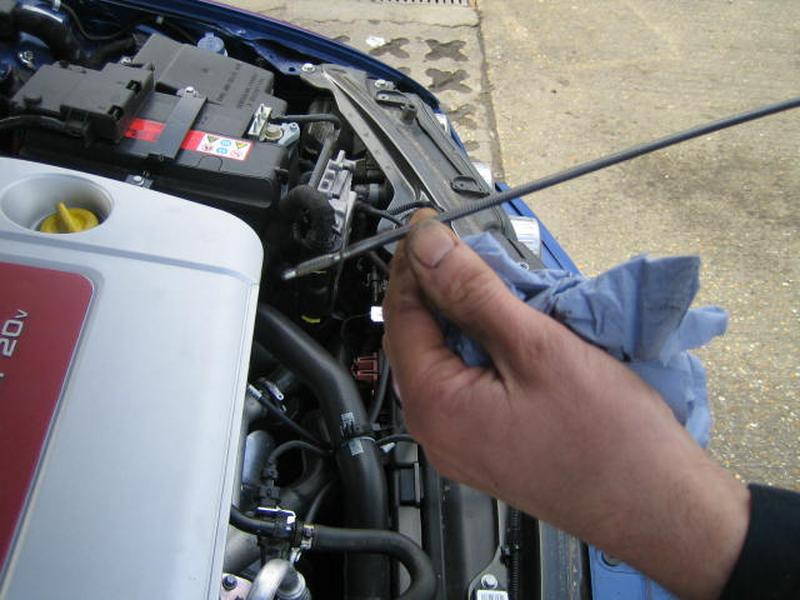 <p>4:- Clean dipstick again and repeat stages 2 and 3, making sure that the second reading is the same as the first. If the reading is not the  same repeat the process again until you get a consistent reading, then top up as required, the area between minimum and maximum is 1 liter