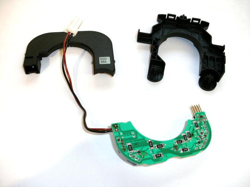 remove the small black circuit board from inside the steering wheel