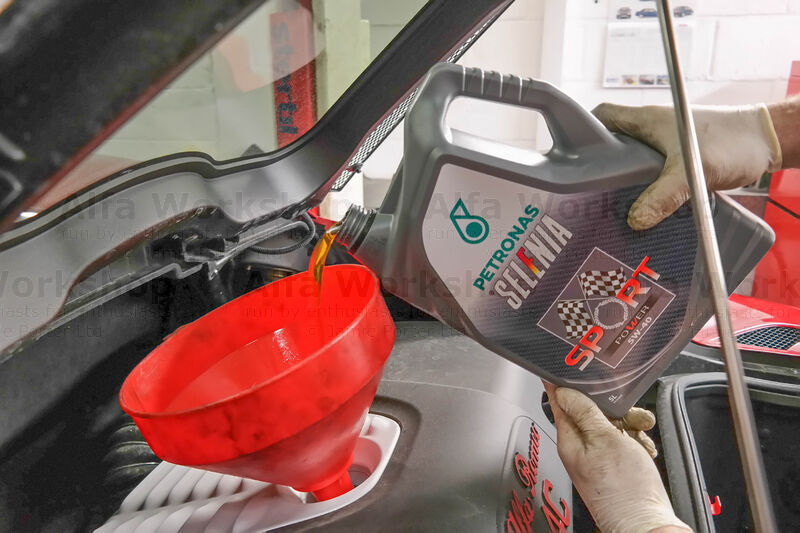 <p>Fill up with 5 litres of the recommended oil and replace the cap.